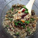 A hearty vegan salad with quinoa, kale, and cranberries.