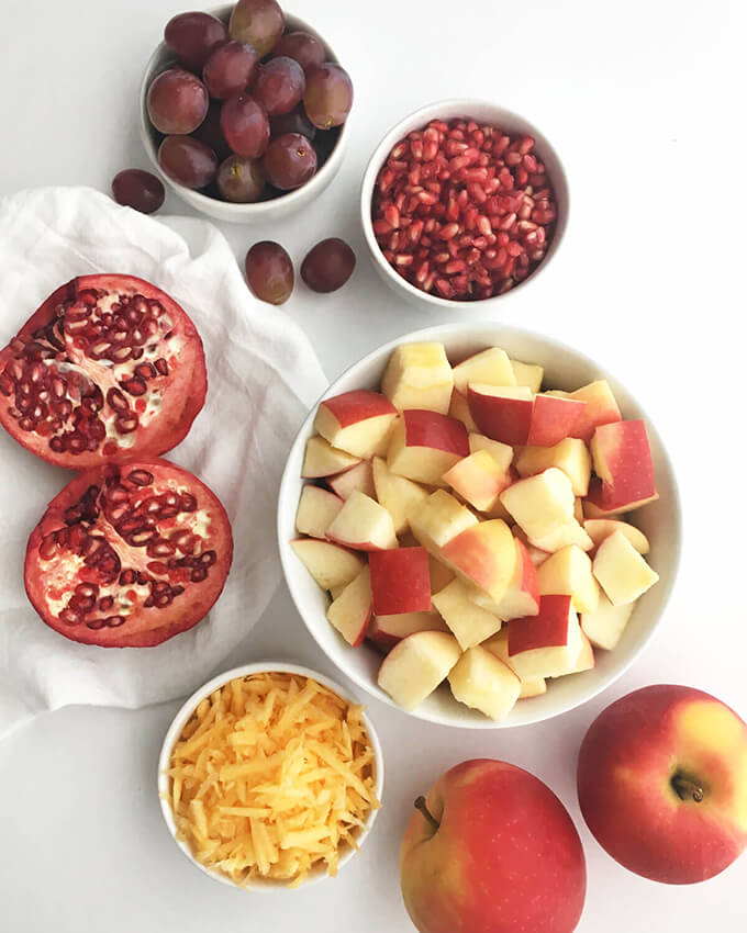 Healthy Fall Fruit Salad: Apples, pomegranate arils, grapes, and shredded pumpkin come together with a delicious creamy dressing to make a fall-inspired, healthy vegan salad.