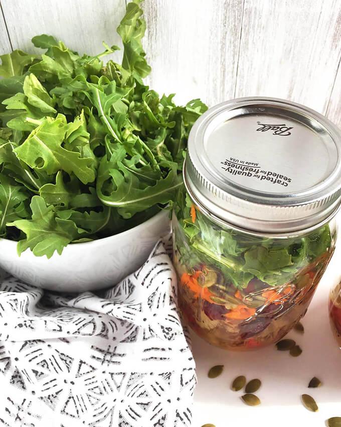 Vegan Mason Jar Salad with apples, arugula, and pepitas