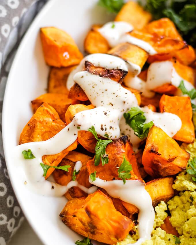 vegan sweet potato breakfast bowl with kale and tofu scramble