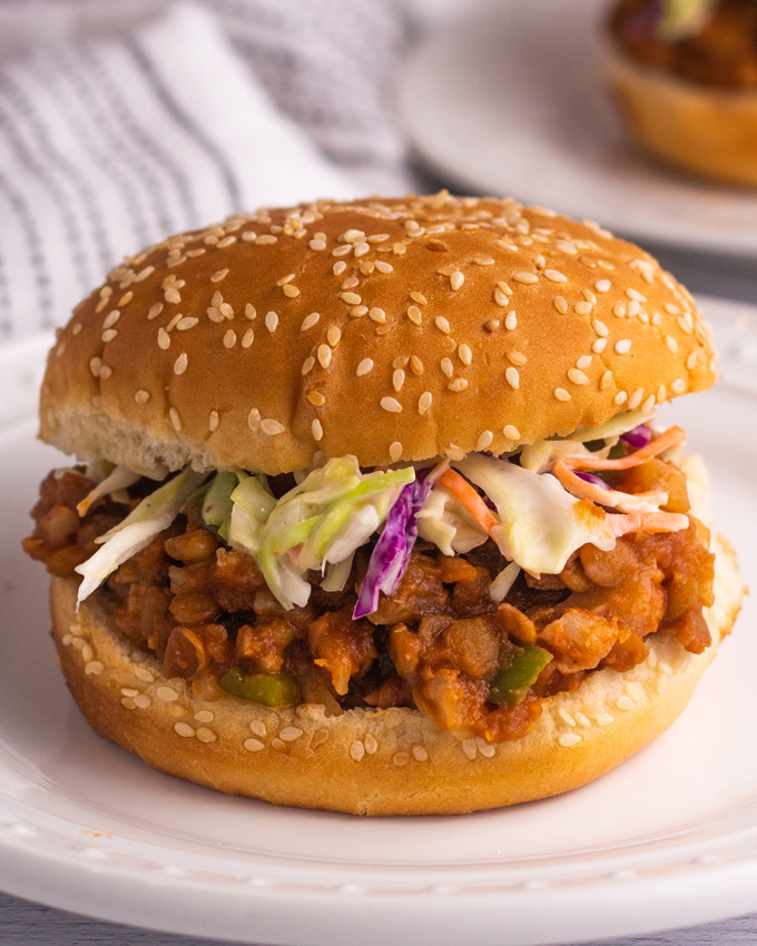 Vegan sloppy joes made with lentils and cauliflower. Topped with coleslaw in a sesame seed bun.