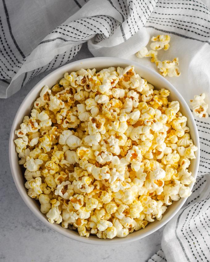 Overhead shot of vegan popcorn in a large white bowl