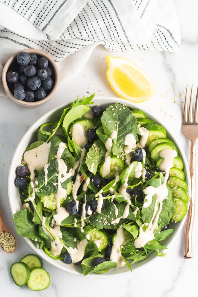 Blueberry Hemp Seed Salad drizzled with a creamy tahini dressing with cucumbers.