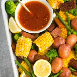 Cajun-inspired vegan no crab boil with corn, potatoes, green beans, and broccoli!