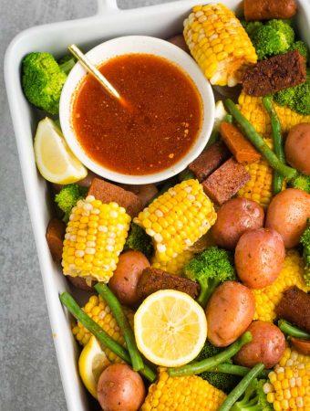 Cajun-inspired vegan no crab boil with corn, potatoes, green beans, and broccoli!