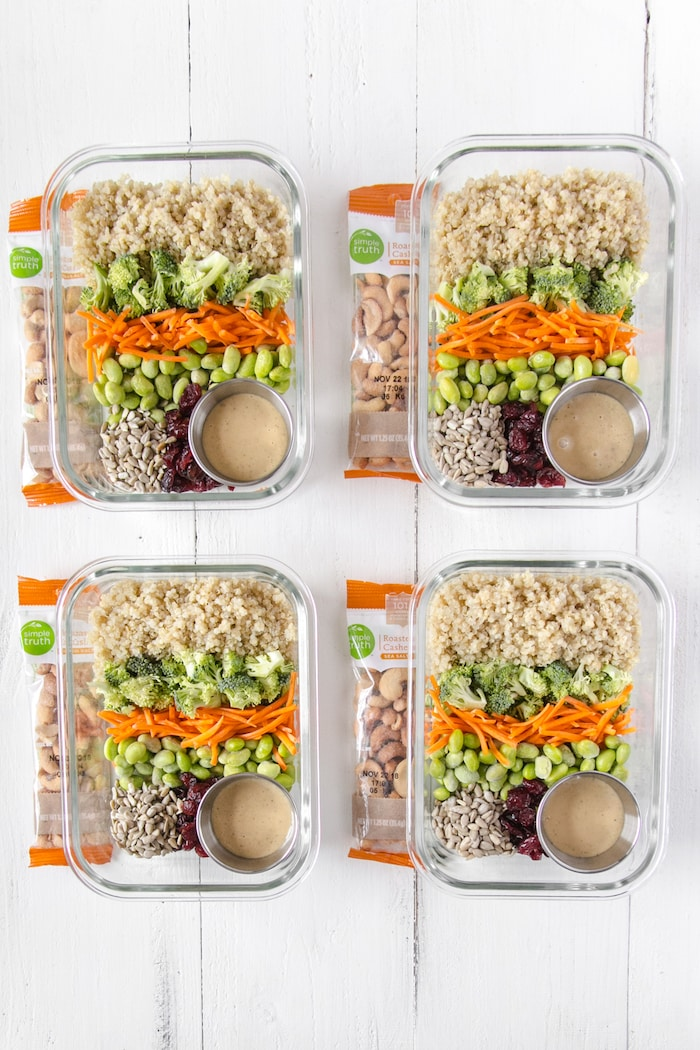 Cold quinoa salad meal prep bowls perfect for a healthy vegan lunch.