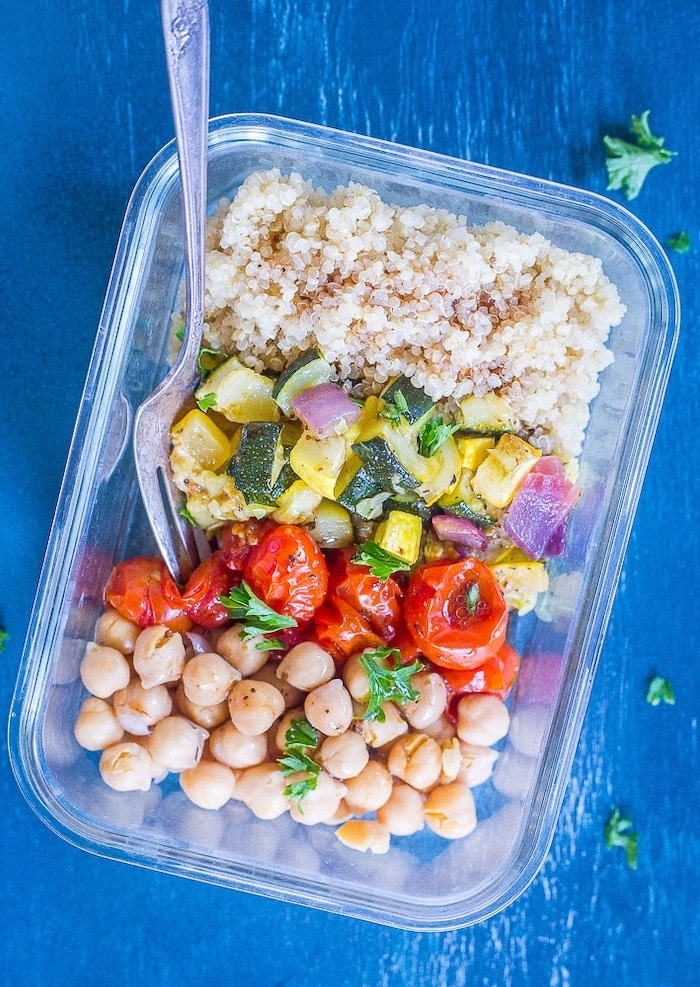 Vegan meal prep lunch with quinoa, roasted summer veggies, and chickpeas.