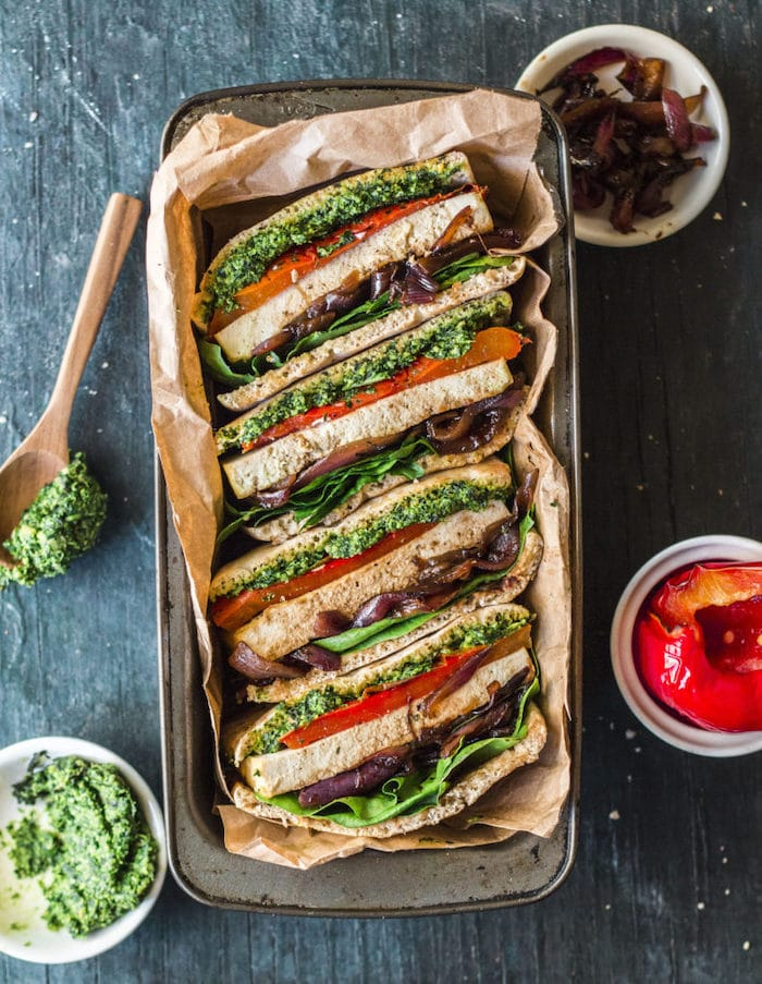 Tofu sandwich with pesto and tomatoes.