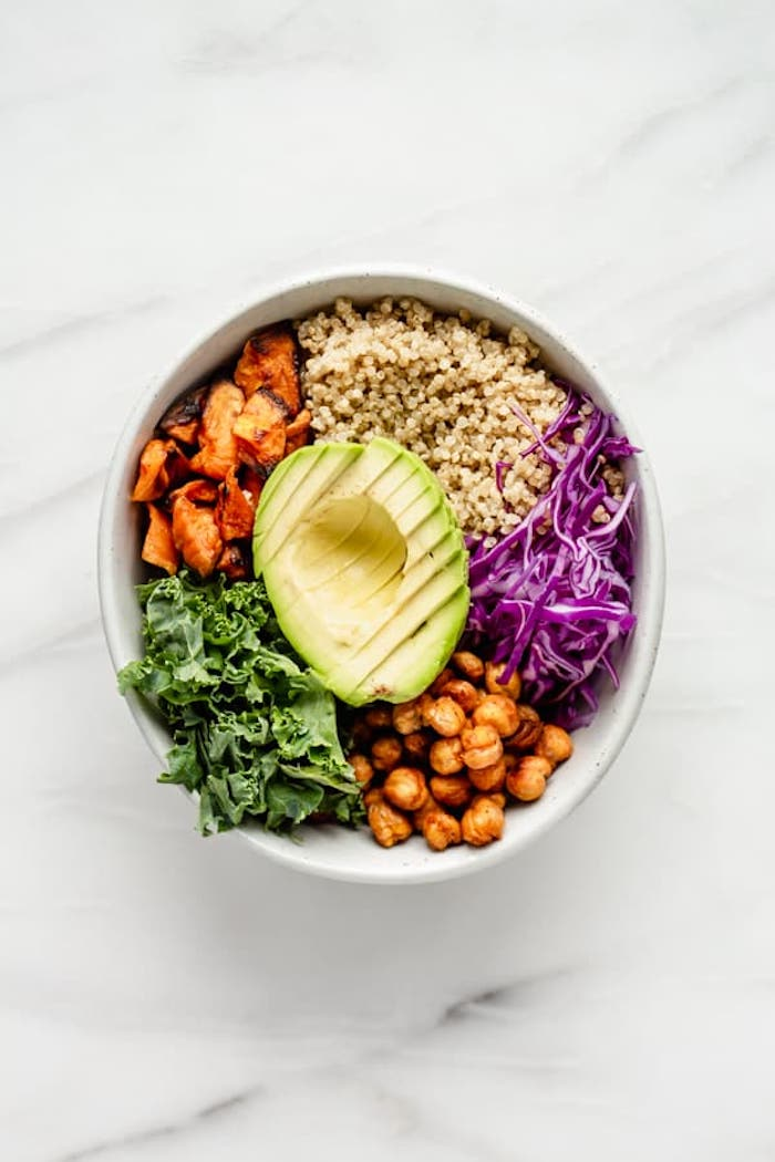 Buddha bowls with kale, chickpeas, cabbage, avocado, quinoa, and more.