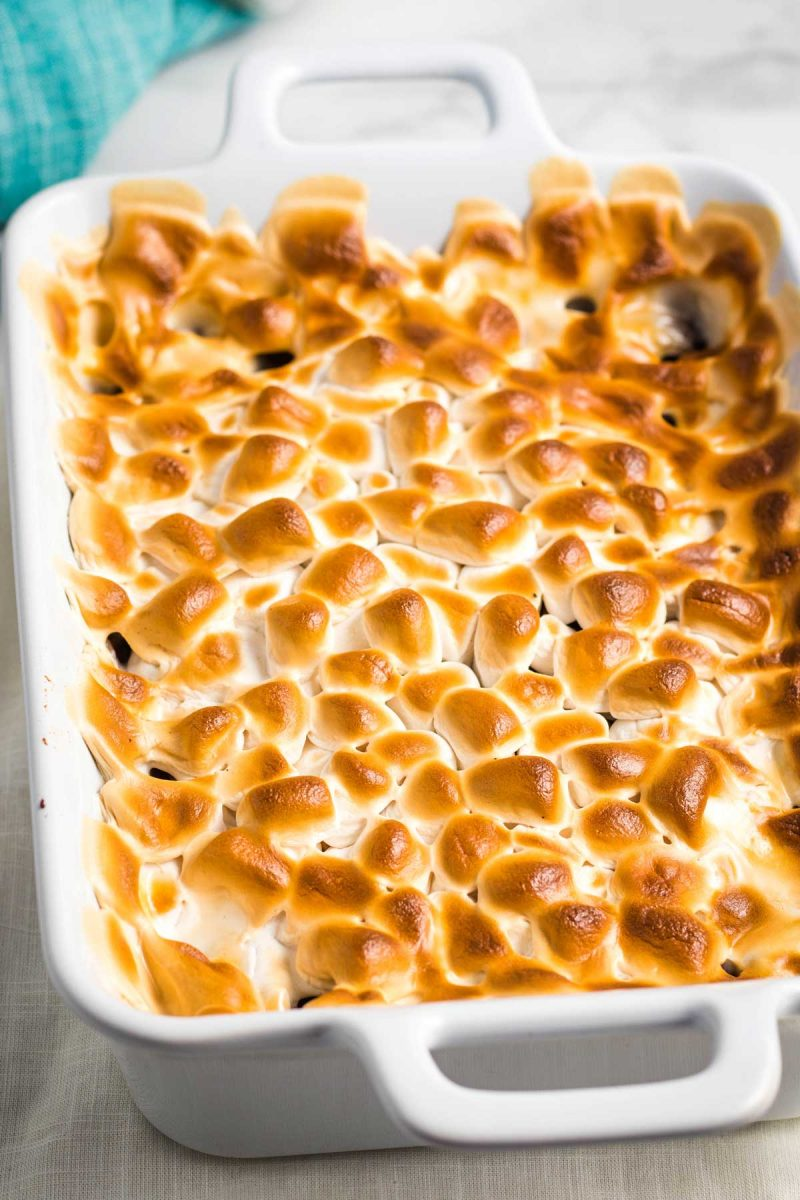 Vegan sweet potato casserole with a browned marshmallow topping.